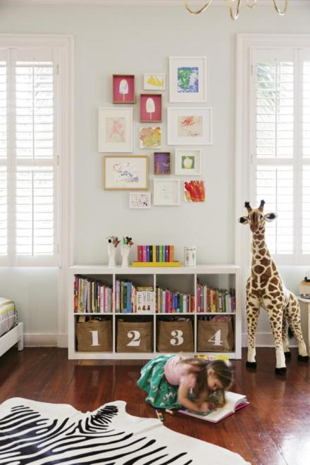 gallery wall over bookcase