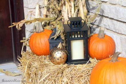 Fall front porch - a touch of gold - painted pumpkins & lanterns & hay & cornstalks - DIY 1