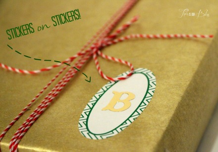 how to wrap pretty presents - sticker monogram embellishments - holiday wrapping ideas - stickers on stickers