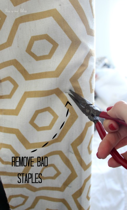 hwo to reupholster a headboard with a curtain panel - remove bad staples with needlenose pliers - this is our bliss