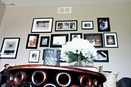Gallery wall layout - monochromatic gallery wall - all black frames - formal living room - gray - this is our bliss
